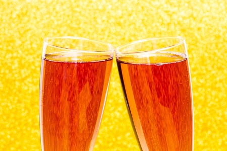 Celebration toast with rose champagne and golden background photo