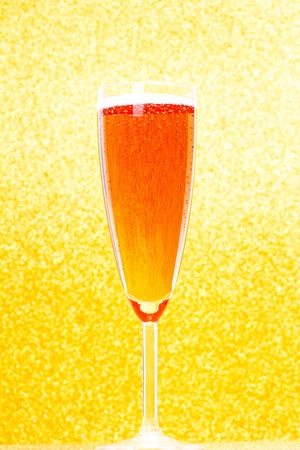 Champagne Flute with golden background photo