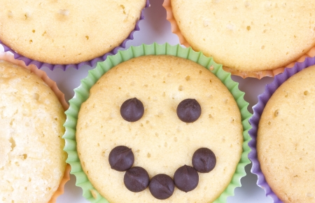 cancellous: Assorted muffins and smile drops Stock Photo
