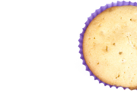 cancellous: Muffin to one side from Top View Isolated on a White Background