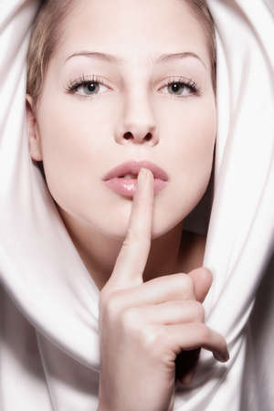 Young pretty woman with white hood