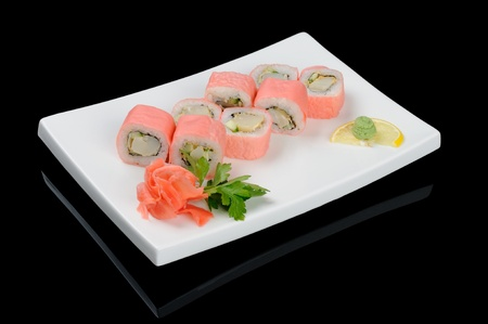 Eight pink soy paper rolls on white plate photo