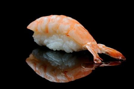 Tiger shrimp sushi on black reflecting background photo
