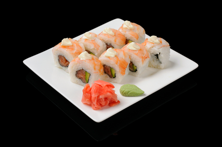 Eight rolls with shrimp and roasted salmon photo