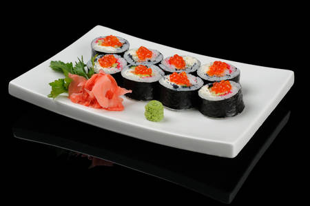 Eight rolls with red caviar served on white plate photo