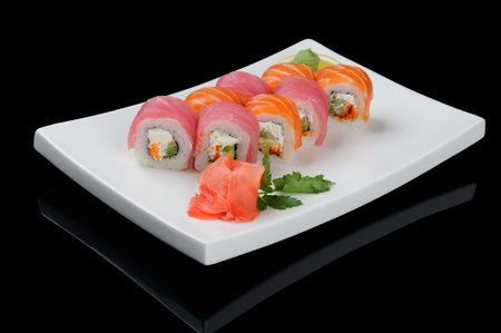 Rolls with salmon and tuna on black photo