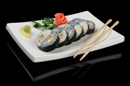 yinyang: Yin-yang rolls served on plate with chopsticks