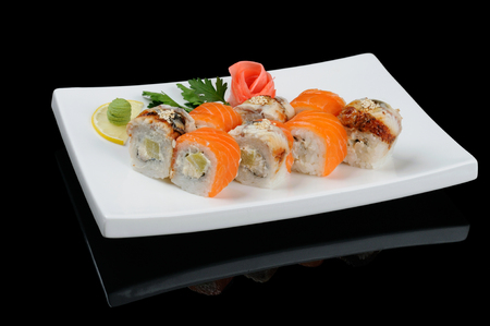Rolls with salmon and smoked eel on white plate photo