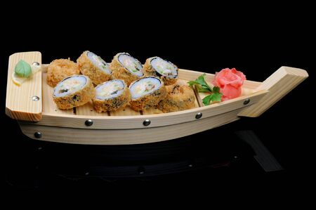 Eight hot rolls on small wooden boat photo