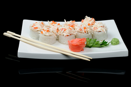 Eight rolls with red caviar and crab photo