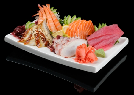 Sashimi seafood assortment on large triangle plate Stok Fotoğraf