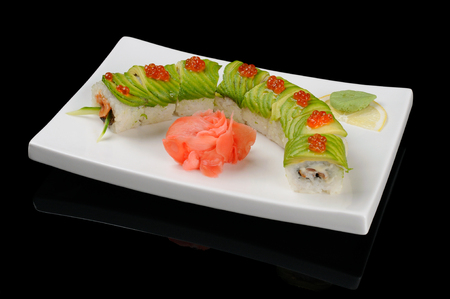 Rolls with avocado and fish looking as a snail photo