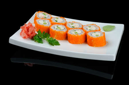 Rolls with flying fish caviar on white plate photo