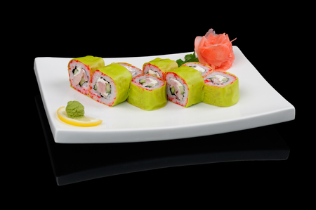 Nice green rolls prepared in special soy paper photo