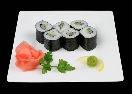 Japanese food  six tasty rolls on white plate photo