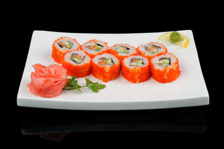 Eight rolls sprinkled by flying fish caviar photo
