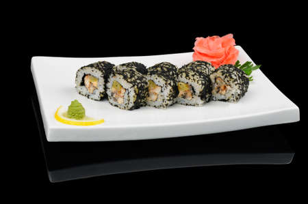 Eight rolls with black flying fish caviar photo