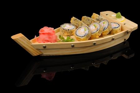 Tasty hot rolls in small wooden  boat photo