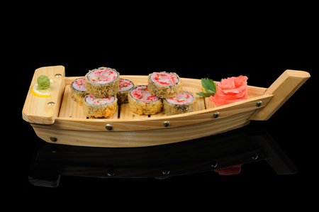 Japanese hot rolls served in the boat photo