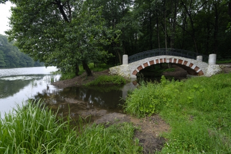 White stone bridge in the park at summer Stock Photo - 25006440
