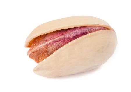 One natural pistachio macro shot on white background photo