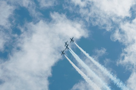 Three aircraft at airshow fly in the sky photo