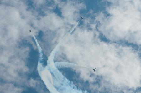 aerobatic:  Three aircraft complete aerobatic maneuver at air display Stock Photo