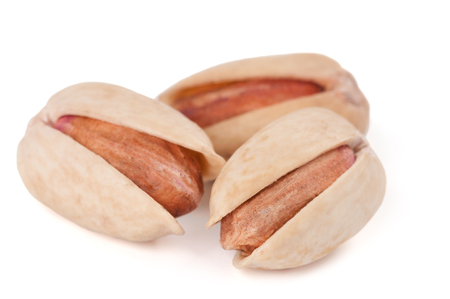Close-up of pistachios isolated on white background photo