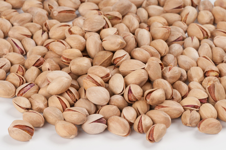 Heap of pistachios isolated on white background photo