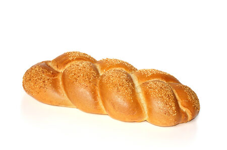 Challah with sesame seeds isolated on white photo