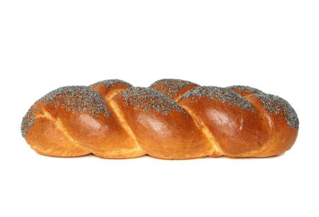 Challah with blue poppy seeds isolated on white photo