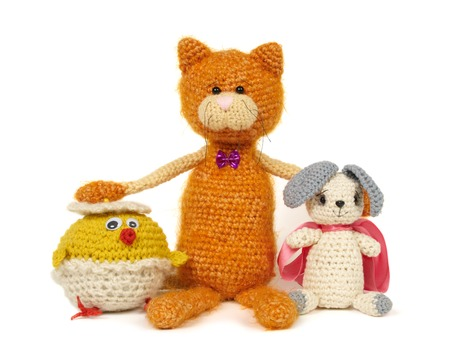 depict: Three knitted toys isolated on white. This image may depict friendship.
