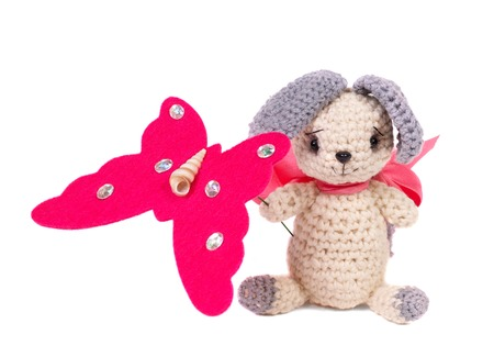 Knitted toy. Hare with butterfly