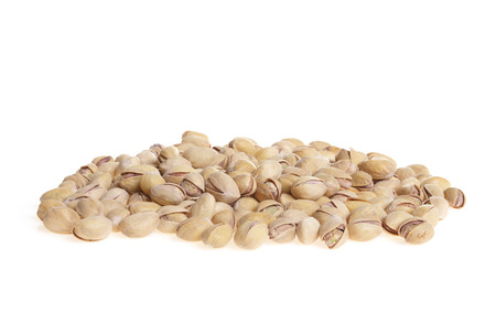 Heap of pistachio nuts isolated on white photo