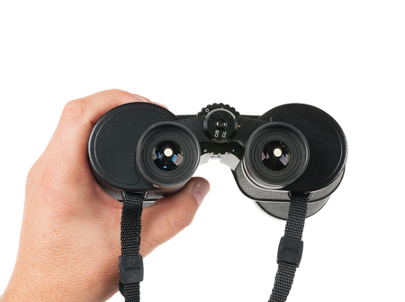 Man holds binoculars. Isolated on the white background