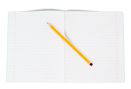 Lined school notebook and pencil over white photo