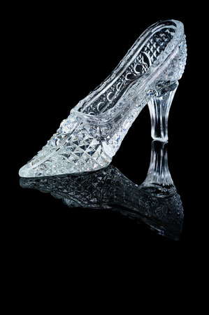 Woman crystal shoe on the black background photo