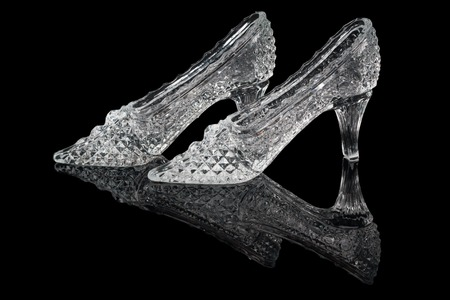 Pair of woman crystal shoes on the black background photo