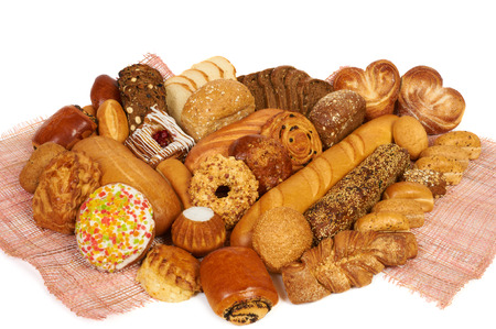 Assortment of bread and pastry composed on the table photo