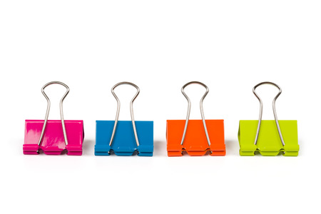 Four binder clips isolated on white background photo