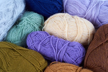 Variety of yarn. View from above on nine skeins. Stock Photo