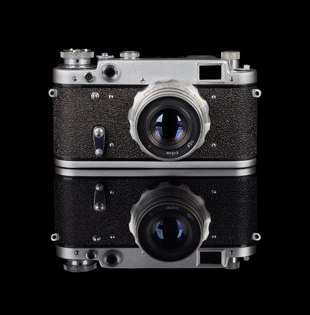 rangefinder: Rangefinder camera isolated on black reflecting background
