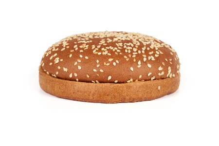 sesame seeds: One dark hamburger bun with sesame seeds sliced in two halves isolated on white background