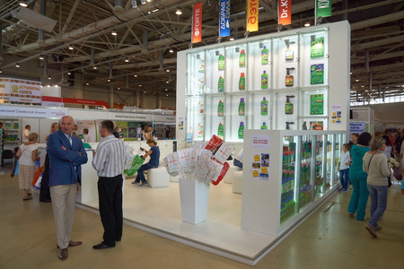 All-Russian Exhibition Center, Moscow, Russia - August 27, 2015: People near the booth of the agricultural company at Moscow international flower show 2015.