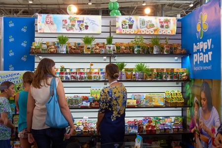 flower show: All-Russian Exhibition Center, Moscow, Russia - August 27, 2015: Visitors look at plants and flowers that grow in packages at Moscow international flower show 2015.