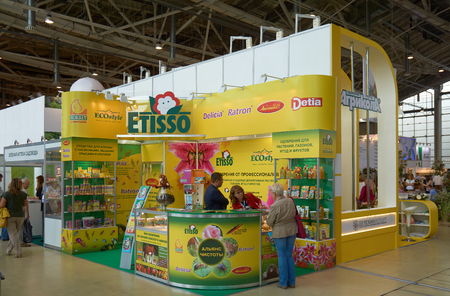 flower show: All-Russian Exhibition Center, Moscow, Russia - August 27, 2015: Booth of the company specialized in fertilizers at Moscow international flower show 2015.