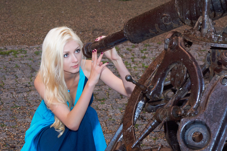 gazer: Young beautiful lady looks through imitation of metal telescope