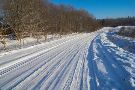 winter road: Beautiful winter road with car tire traces