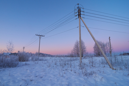 powerline: Powerline in the countryside with beautiful crimson sky in the background Stock Photo