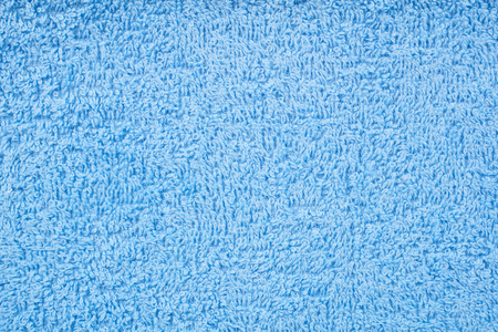 Blue terry towel as a seamless background Imagens